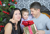 Lucky family near new year's fir tree — Stock Photo