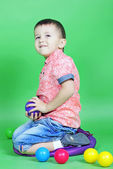 Small boy on green background — Stock Photo