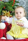 Small girl near new year's fir tree — Stock Photo