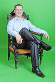 Young business man in a blue shirt in the chair — Stock Photo