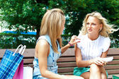 Two women with shopping — Stock Photo
