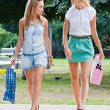 Two girls walking in the park — Stock Photo #13514314