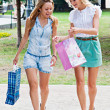 Two girls walking in the park — Stock Photo