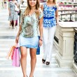The two women go shopping in a mall — Stock Photo #14573429