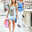 The two women go shopping in a mall — Stock Photo