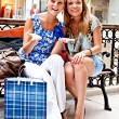 Two women in a shopping center — Stock Photo