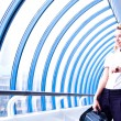 Business woman looks at the clock — Stock Photo #14898665