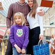 Family is shopping in a store - Stock Photo