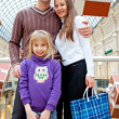 Family is shopping in a store — Stok fotoğraf