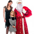 Santa Claus and a mother and daughter - Stock Photo