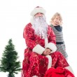 Santa Claus and little girl - Stock Photo