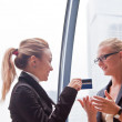 Business woman with a credit card — Stock Photo #16282393
