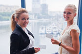 Two Women in Business with Business Cards — Stock Photo