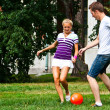 Stock Photo: Man and woman playing football