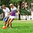 Man and woman playing football — Stock Photo #18002143
