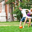 Man and woman playing football — Stock Photo #18002161