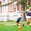 Man and woman playing football — Stock Photo #18002165