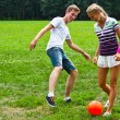 Man and woman playing football — Stock Photo #18002193