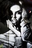 Portrait of a woman with graffiti — Stock Photo
