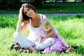 Mother and daughter walking in the park — Stock Photo