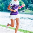 Woman running in the park — Stockfoto
