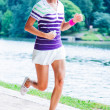 Stock Photo: Womrunning in park