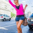 The girl stops a taxi - Stock Photo