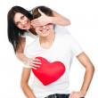 Woman gives a man a heart — Stock Photo #19604427