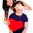 Mom gives daughter heart — Stock Photo