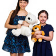 Two girls with toys — Stock Photo