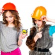 Stock Photo: Two girls in construction helmets