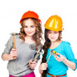 Two girls in construction helmets — Stock Photo