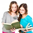 Two girls read books — 图库照片