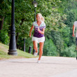 Stock Photo: A man and a woman running in the park