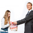Man gives a woman a gift — Stock Photo