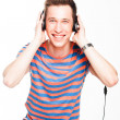 Man listens to music on headphones — Stock Photo #26026877