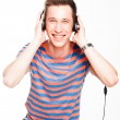 Man listens to music on headphones — Stock Photo