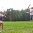 A man playing a woman in badminton — Stock Photo