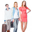 Two women and a luggage porter — Stock Photo