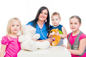 Dr. and children — Stock Photo