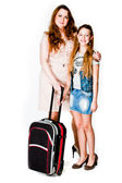 Two girls with suitcase — Stock Photo