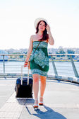 Woman with a suitcase — Stock Photo