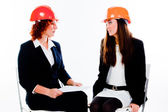 Two women in construction helmets — Stock Photo