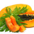 Ripe papaya with seeds and green leaf isolated on a white backgr — Stock Photo #24070489