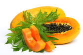 Ripe papaya with seeds and green leaf isolated on a white backgr — Stock Photo
