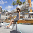 Young woman take a picture her friend on sailboat — Foto de Stock