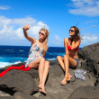 Two girls taking photo on the beach in summer holidays and vacat — Stock Photo #42030729