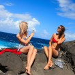 Two girls taking photo on the beach in summer holidays and vacat — Stock Photo #42031205