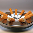 Cigarette butts and ashtray — Stock Photo