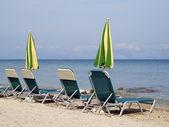 Sunbeds and umbrellas — Stock Photo